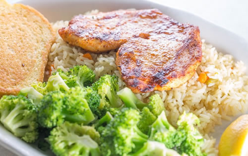 Marinated Chicken Breast Over Rice Pilaf